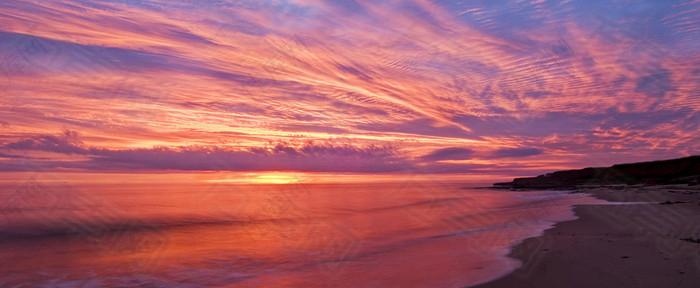 晚霞海风沙滩背景图